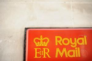 A Royal Mail logo is pictured on a postal box ...