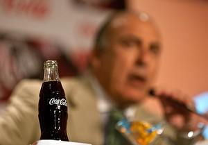A Coca-Cola bottle is pictured as Muhtar Kent,...