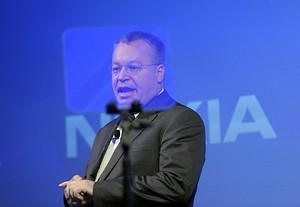 Former Nokia CEO Stephen Elop speaks during th...