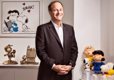 Man with a dream: Iconix chief Neil Cole thinks the iPad generation will learn to love Lucy, Linus, Snoopy and the gang.