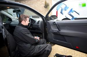 Mechanic installs an Insure the Box telematics device into a car (Photo courtesy of Insure the Box).