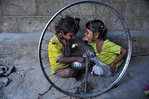 Indian children eat food at their temporary sh...