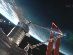 The station's robotic arm grappling the Cygnus spacecraft. (Credit: NASA TV)