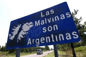 Vehicle passes by a sign that reads ″The Malvinas (Falklands) are Argentine″ on Route 136, near the Argentine city of Gualeguaychu (PHOTO by Marcos Brindicci/REUTERS)
