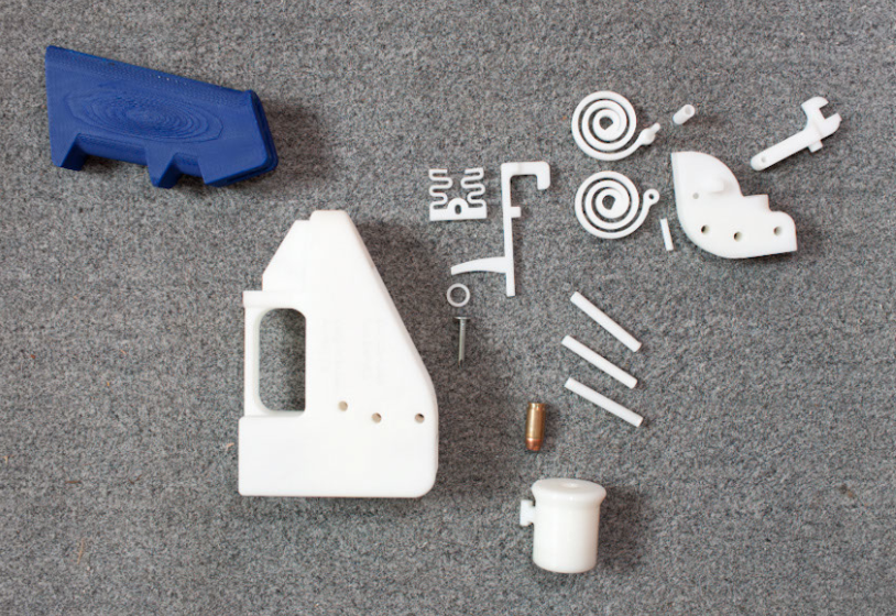 The sixteen pieces of Defense Distributed's printed handgun, including spiral springs for its hammer mechanism and a nail used as its firing pin. Click to enlarge. (Credit: Michael Thad Carter for Forbes)