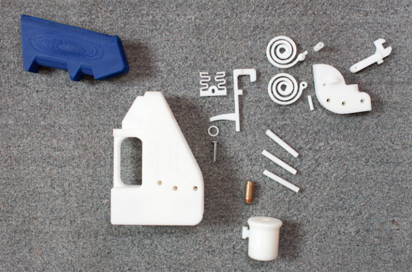 The sixteen parts of Defense Distributed's 3D-printable gun, the Liberator.