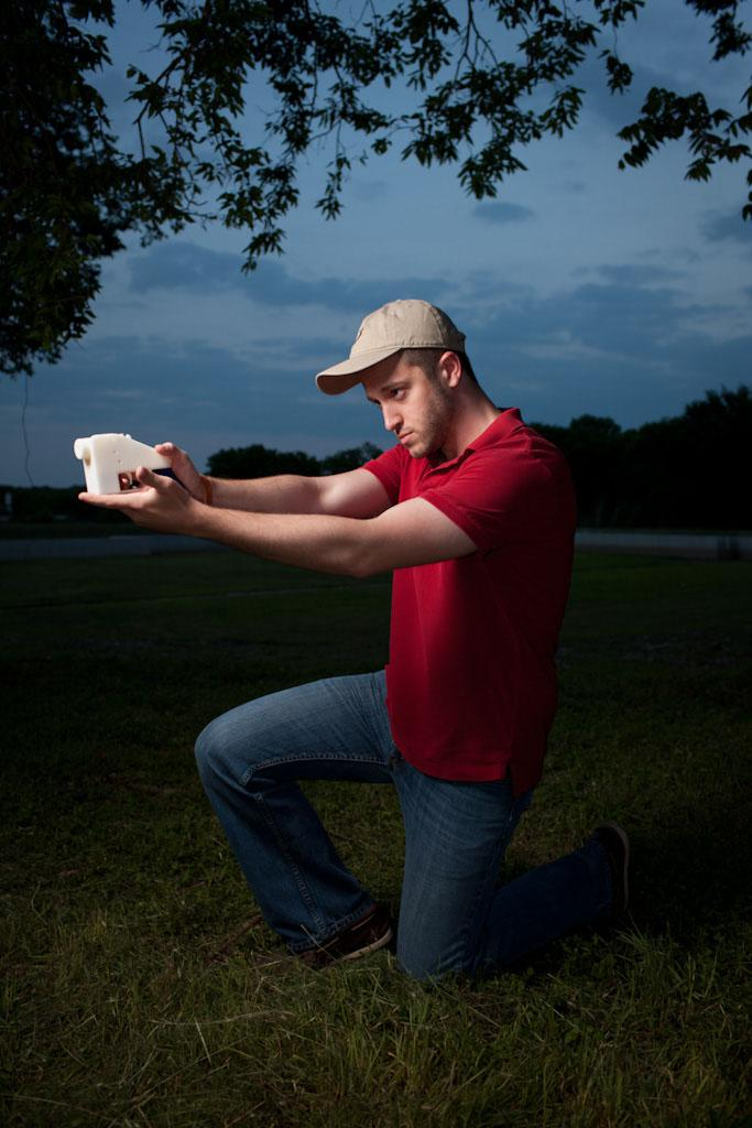 Defense Distributed founder Cody Wilson, holding the world's first fully 3D-printed gun. Click to enlarge. (Credit: Michael Thad Carter for Forbes)