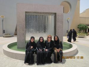 Abaya-clad Saudi leaders and Anne Doyle at Prince Mohammad University, Dhahran, Saudi Arabia