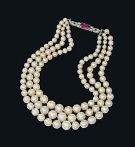 Three-strand natural pearl necklace sold for more than $1.6 million.