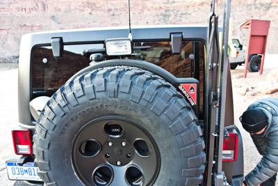 AEV's multi-purpose tire carrier / 10 gallon gas can / shovel and jack carrier. Image credit: Den... [+] Bradshaw