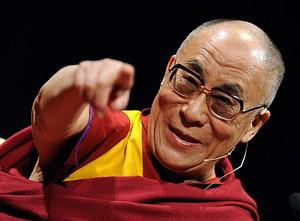 The XIV Dalai Lama speaks during a conference ...
