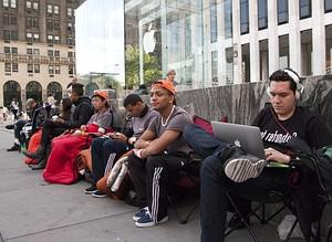 Customers line up outside the Apple store on 5...
