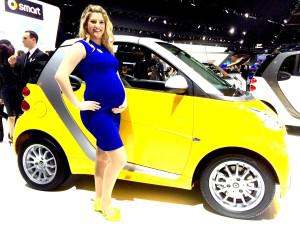 Baby on Board: Smart car model Jennifer Parmenter poses on the Detroit show stand.