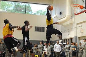 LeBron James (right) prepares to dunk a basket...
