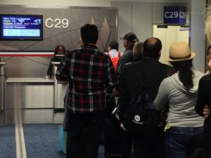 Frustrated passengers wait in line after AA cancelled flights at DFW airport. @2013 UTA LLC.