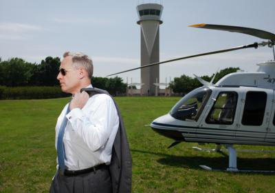 Perot, with helicopter, at AllianceTexas. Credit: Michael Thad Carter for Forbes