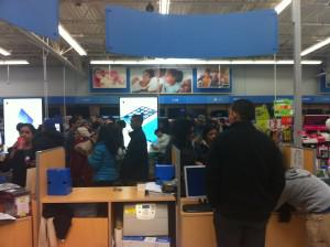 At a Walmart Supercenter in Secaucus, NJ on Black Friday morning, long lines snaked around the electronics department.
