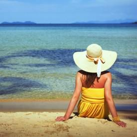 Photo of woman on beach courtesy of Shutterstock.