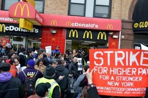 A coalition of groups rally in front of a McDo...