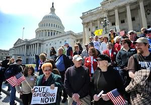 Protesters demonstrate in front of the Capitol...