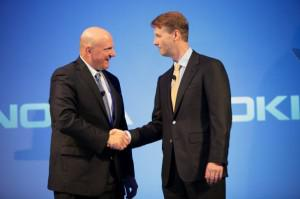 Siilasma and Ballmer shake hands at the Nokia press conference