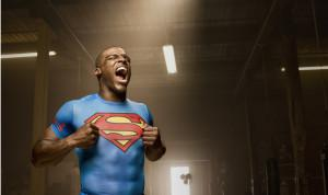 "Cam Newton in an ""Alter Ego Superman"" Under Armour Compression Top."