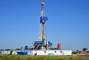 An oil well being drilled August 23, 2011 near...
