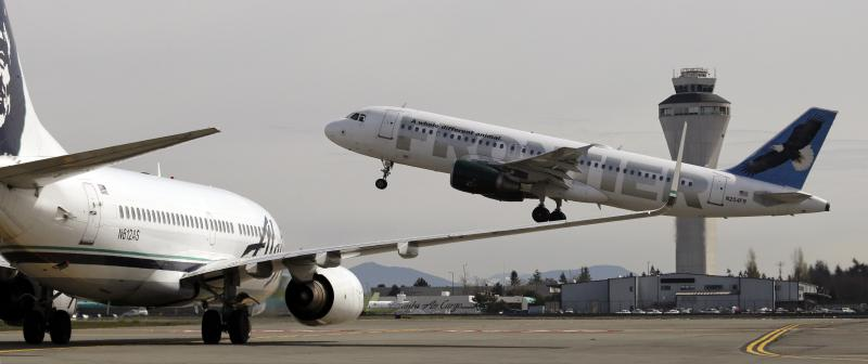 Jets waited to depart Sea-Tac Airport on April 23, 2013. (AP Photo/Elaine Thompson)
