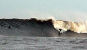 Scott surfing a big roller at Thurso East, a break on the north coast of Scotland.