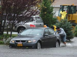 Mark Linden (in orange cap), co-founder of Sharpe Concepts in Babylon, NY, offering and receiving... [+] help in the aftermath of the storm.