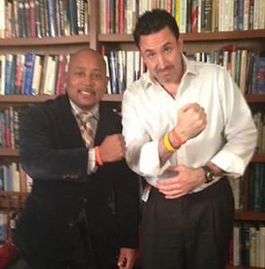 Daymond John (left) and MJ Gottlieb sport CAM bracelets in support of David Williams' son.