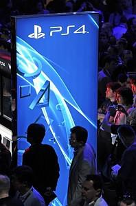 Attendees wait in line to use Sony PlayStation...