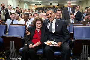 President Barack Obama presents cupcakes with ...