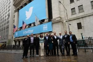 Twitter founders and management team pose in f...