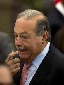 Mexican tycoon Carlos Slim gestures during a d...