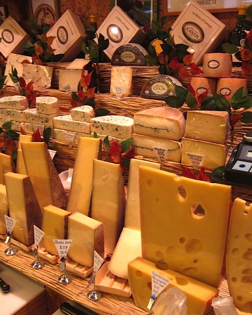 Magnificent hard cheeses in foreground, like Emmenthaler