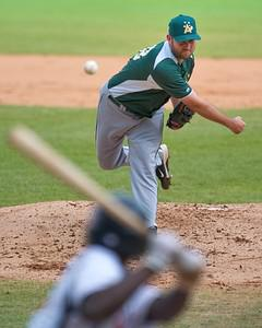 Australian pitcher Rusic Dushan pitches the ba...