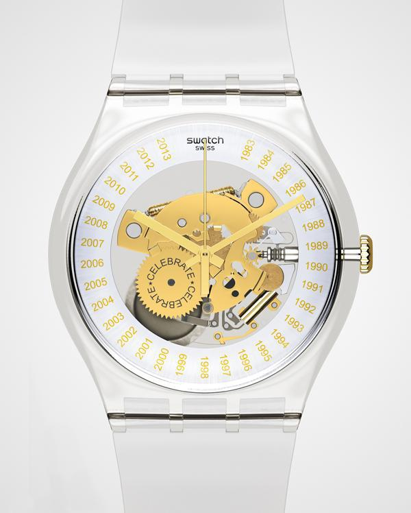 This anniversary Swatch is housed in a transparent plastic case and strap; a skeletonized dial... [+] offers a view of key movement components highlighted in gold