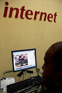 A Cuban checks internet at a cyber place in Ha...
