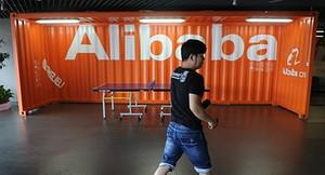 A Chinese Alibaba employee walks through a com...