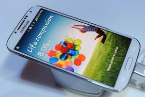 Samsung's new Galaxy S4 is seen during its unv...