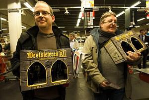 Two men hold their special cases of Westvleter...