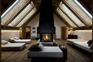 The hotel's top room, the duplex Panorama Suite, has its own spa, which includes this dramatic relaxing room.
