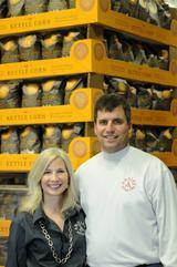 "Angie Bastien of Angie's Popcorn (shown here with her husband, Dan) encourages us to include our children in the business and ""get outside"". She plants a organic garden annually with her children."