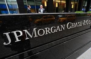 Two men speak outside JP Morgan Chase & Co hea...