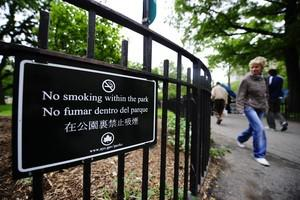 A sign announcing 'No smoking withing the park...
