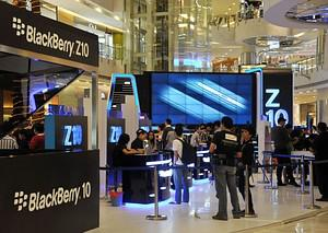 People attend the Blackberry Z10 phone launch ...