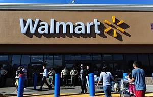Police man the front of a Walmart store amid h...