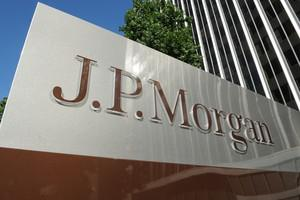 A JPMorgan sign is seen outside the office tow...