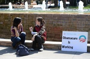 An Affordable Healthcare Act supporter (R) tal...
